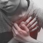 woman chest pain, monochrome